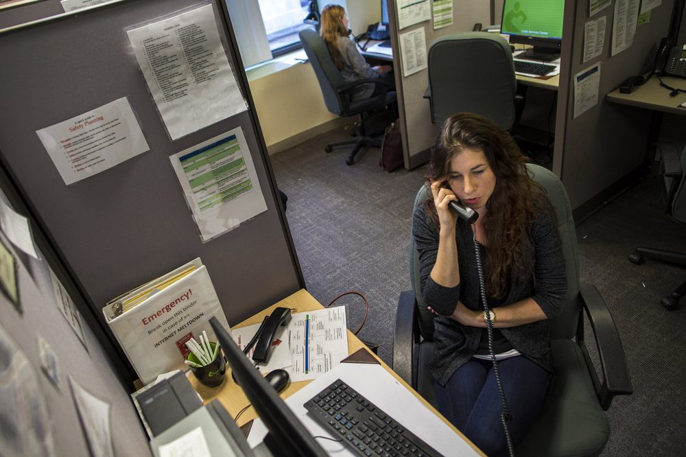 Volunteer Emma speaks with a caller on the Samaritans hotline in its in-person days. (Jesse Costa/WBUR)