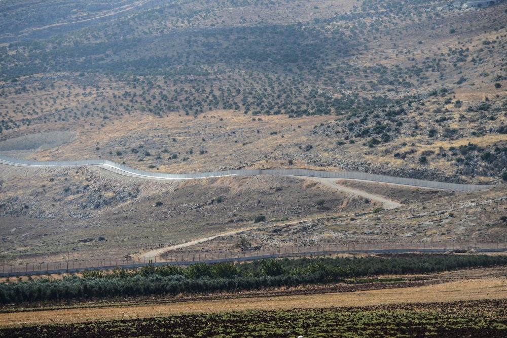 A picture taken on Oct. 9, 2017 from the Reyhanli district in Hatay, southern Turkey, shows the border wall separating Turkey from Syria. (Ilyas Akengin/AFP/Getty Images)
