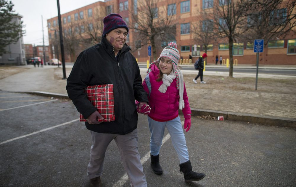 Francisco Rodriguez, an undocumented immigrant, picks up his daughter from school in Chelsea after being released from immigration custody. He still faces deportation. (Jesse Costa/WBUR)