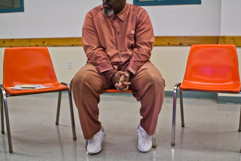 A FACT member at a meeting inside Graterford State Prison. (Kimberly Paynter/WHYY)