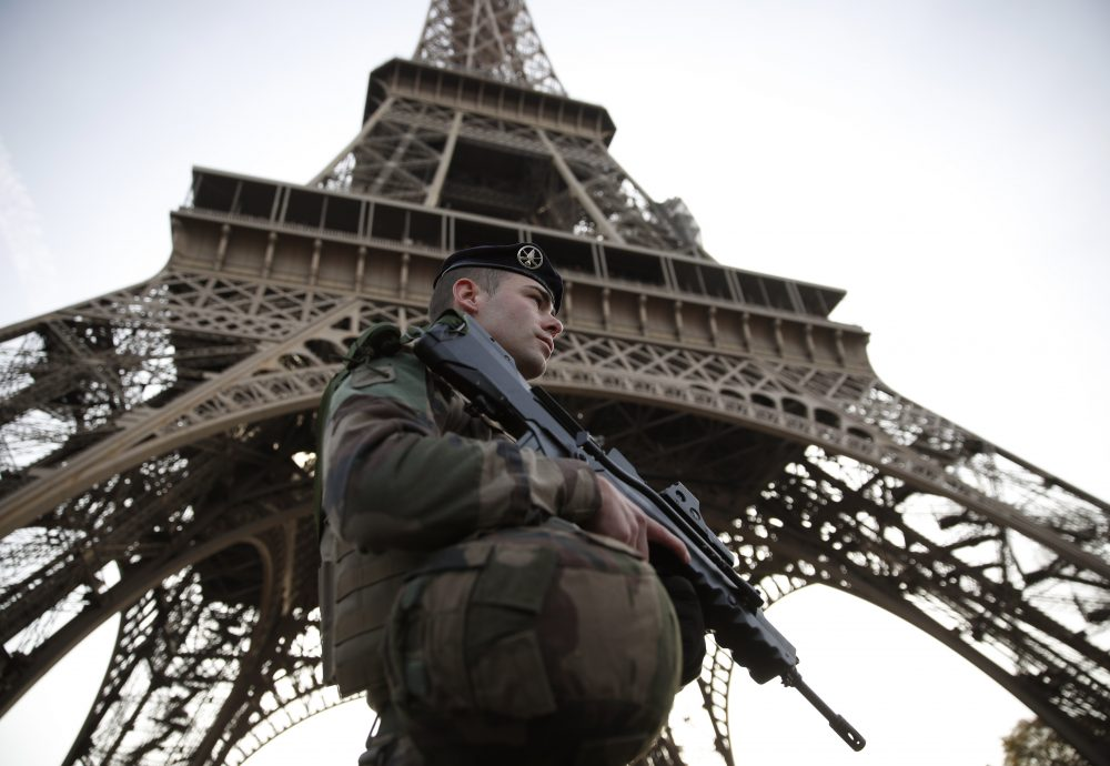 A French soldier patrols in front of the Eiffel Tower on Nov. 1, 2017, in Paris. (Christian Hartmann/AFP/Getty Images)