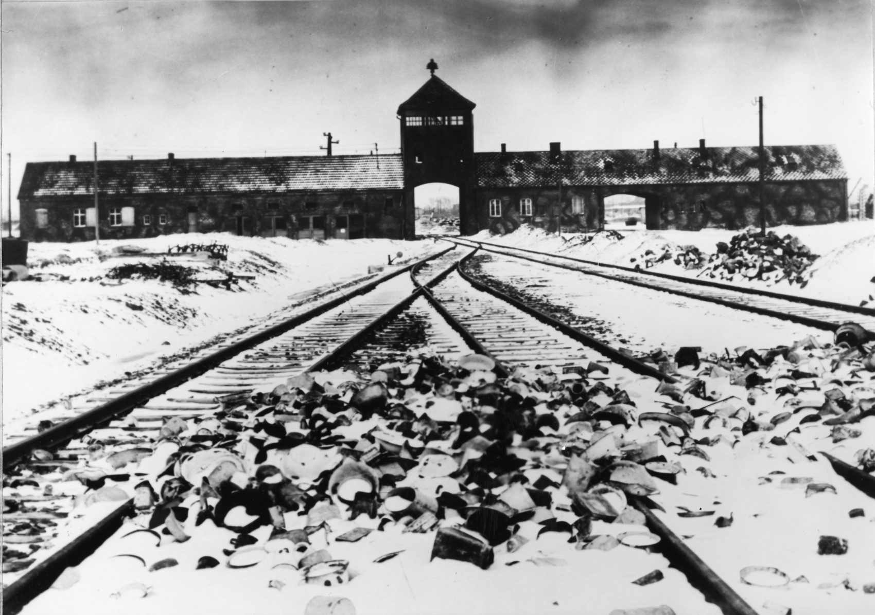 Entry to the concentration camp Auschwitz-Birkenau, Poland, with snow covered railtracks leading to the camp in February/March 1945. (Stanislaw Mucha/AP)