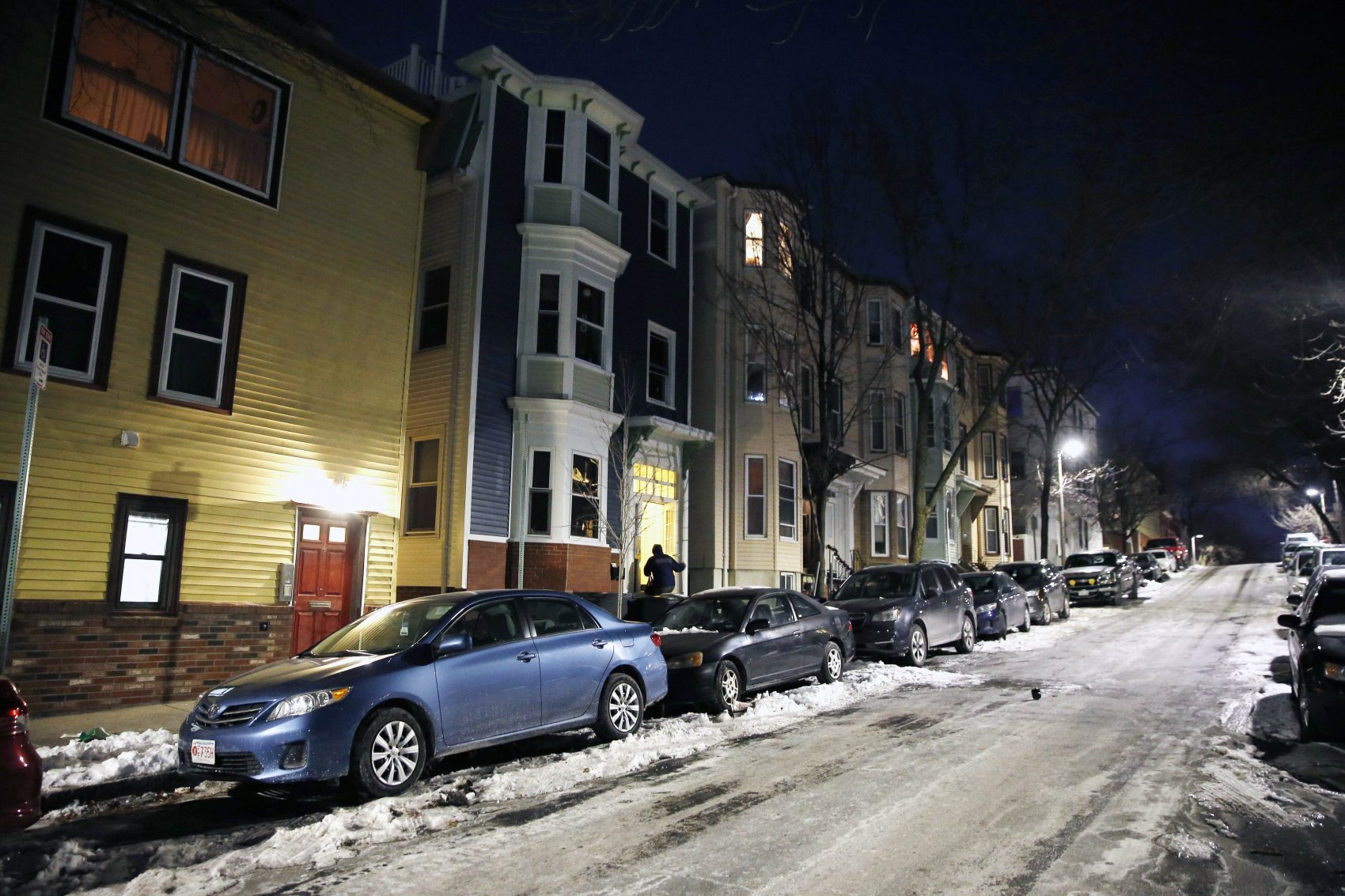 A person enters an apartment building on an icy street in the East Boston neighborhood of Boston as the temperature hovers in the single digits, Thursday, Dec. 28, 2017. The National Weather Service said there's the potential for record-breaking cold this week in New England. (AP Photo/Michael Dwyer)