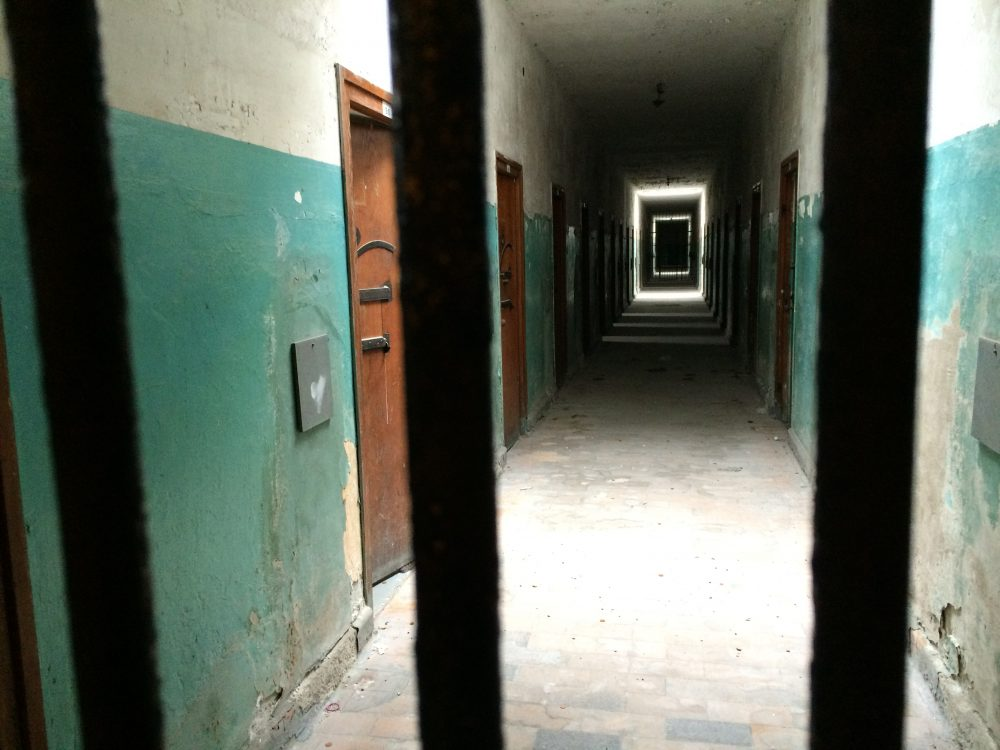 Basement detention cells in the former Dachau concentration camp bunker, Germany, 2015. (Courtesy Andrea Pitzer)