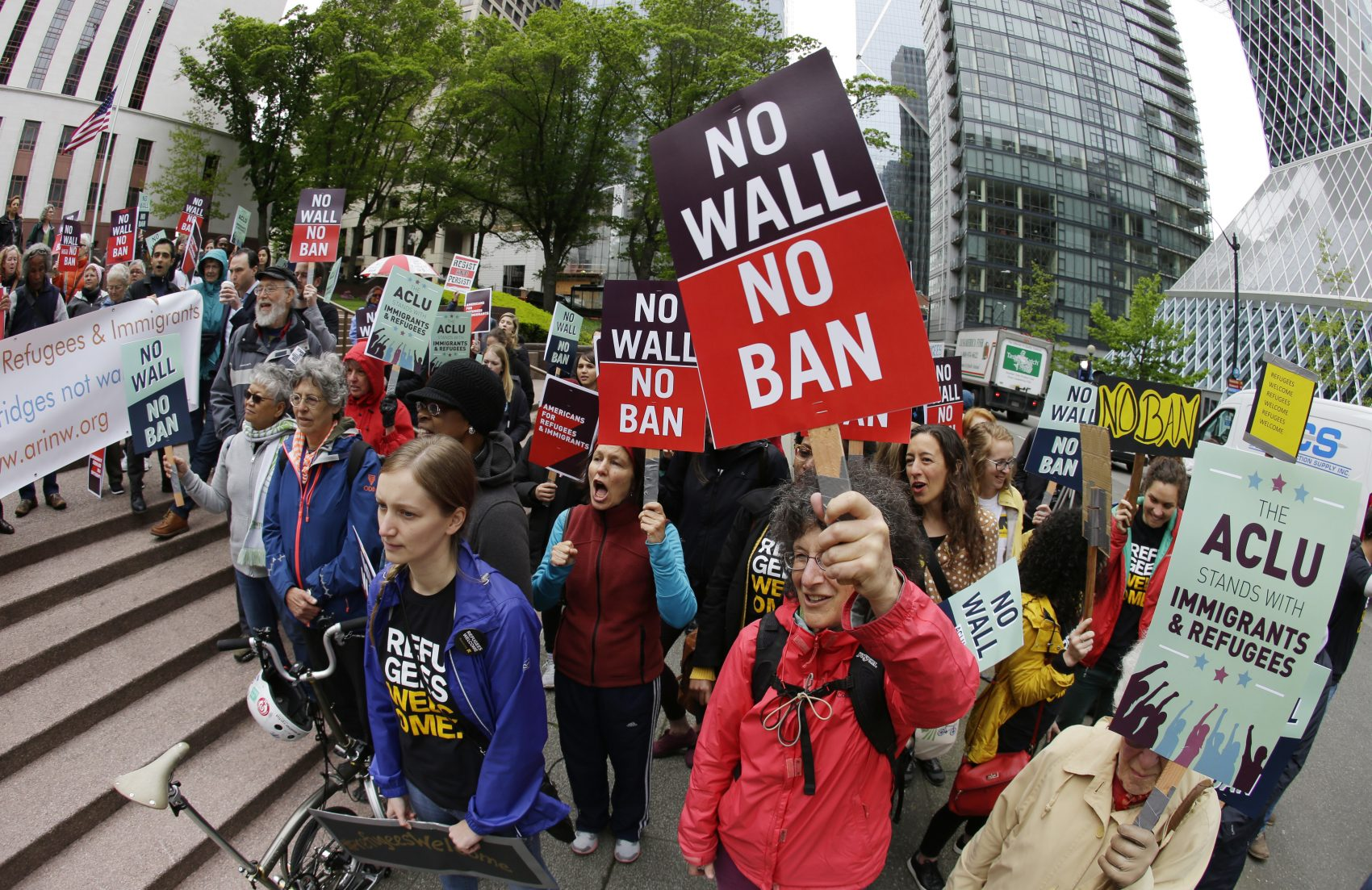 In this May 15, 2017, file photo, protesters wave signs and chant during a demonstration against President Donald Trump's revised travel ban outside a federal courthouse in Seattle. (Ted S. Warren/AP)