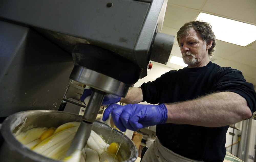 In this 2014 file photo, Masterpiece Cakeshop owner Jack Phillips cracks eggs into a cake batter mixer inside his store in Lakewood, Colo. (Brennan Linsley/AP)