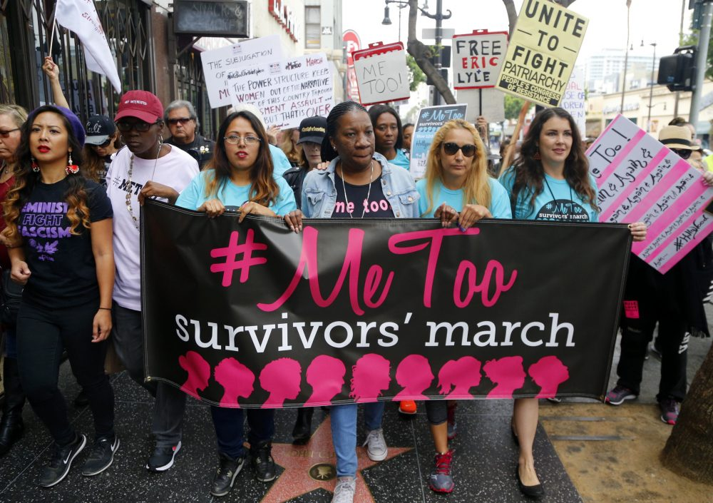 Participants march against sexual assault and harassment at the #MeToo March in Los Angeles on Nov. 12. (Damian Dovarganes/AP)