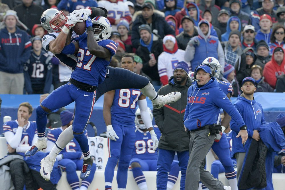 New England Patriots tight end Rob Gronkowski, left, makes a catch as Buffalo Bills cornerback Tre'Davious White (27) defends during the second half of an NFL football game, Sunday, Dec. 3, 2017, in Orchard Park, N.Y. Bills head coach Sean McDermott, right, looks on during the play. (Adrian Kraus/AP)