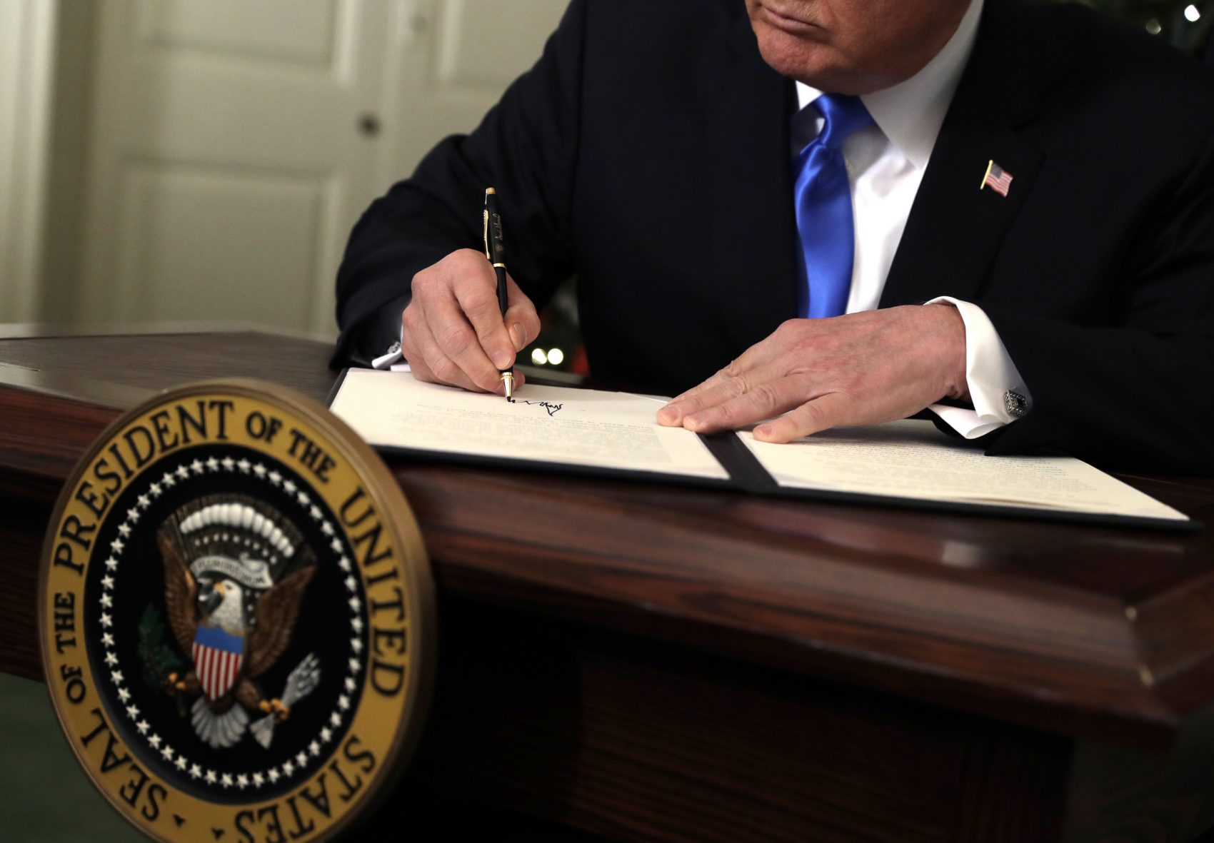 President Donald Trump signs a proclamation to recognize Jerusalem as the capital of Israel in the Diplomatic Reception Room of the White House, Wednesday, Dec. 6, 2017, in Washington. Trump recognized Jerusalem as Israel's capital despite intense Arab, Muslim and European opposition to a move that would upend decades of U.S. policy and risk potentially violent protests. (Evan Vucci/AP)