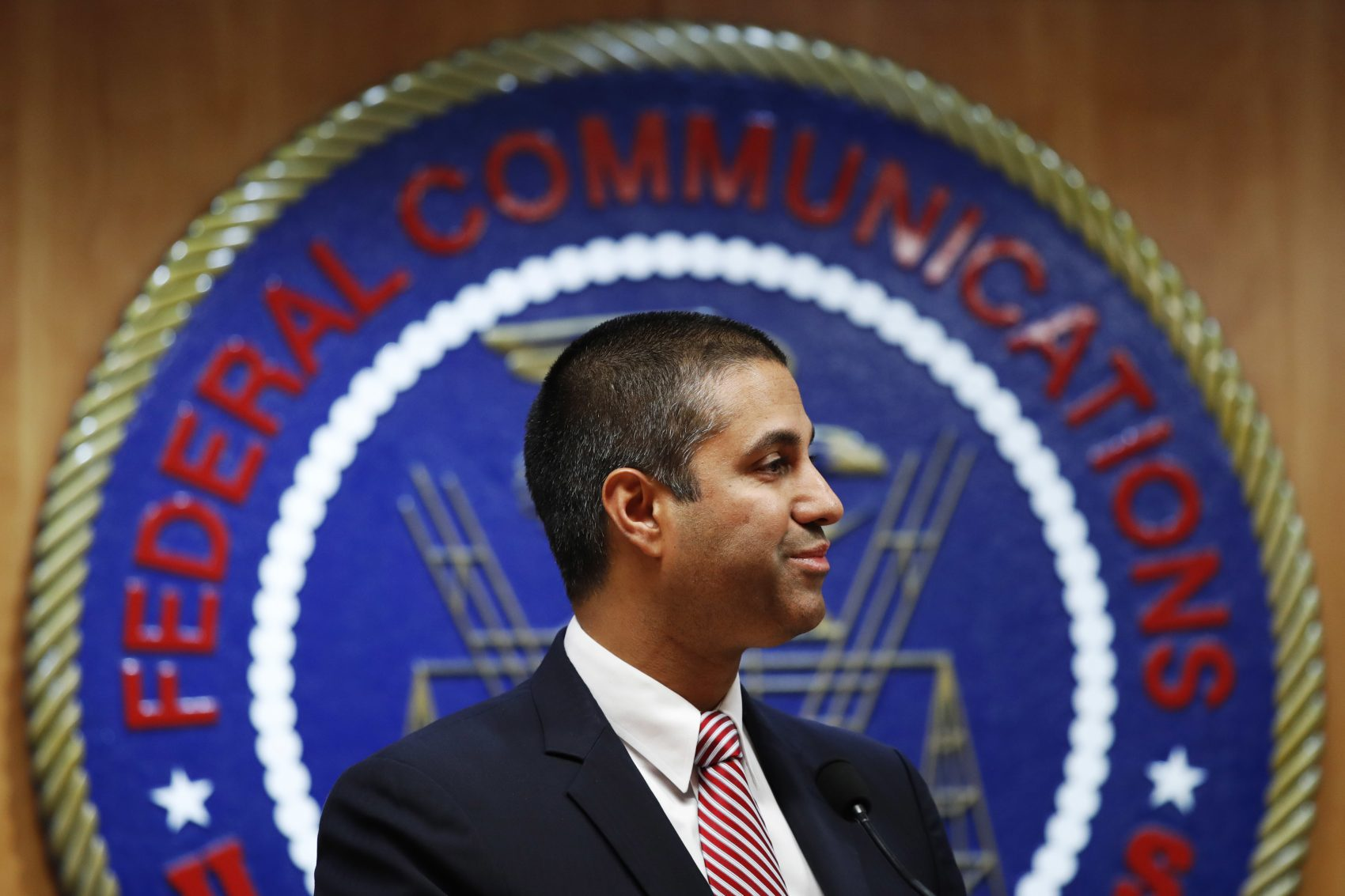 After a meeting voting to end net neutrality, Federal Communications Commission (FCC) Chairman Ajit Pai smiles while listening to a question from a reporter, Thursday, Dec. 14, 2017, in Washington. (Jacquelyn Martin/AP)
