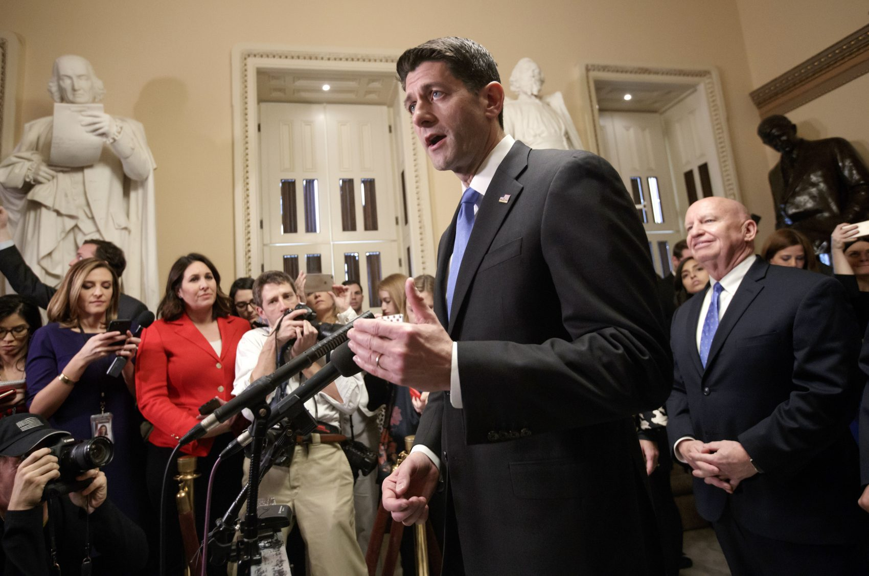 Speaker of the House Paul Ryan, R-Wis., joined at right by House Ways and Means Committee Chairman Kevin Brady, R-Texas, meets reporters just after passing the Republican tax reform bill in the House of Representatives, on Capitol Hill, in Washington, Tuesday, Dec. 19, 2017. The vote, largely along party lines, was 227-203 and capped a GOP sprint to deliver a major legislative accomplishment to President Donald Trump after a year of congressional stumbles. (J. Scott Applewhite/AP)