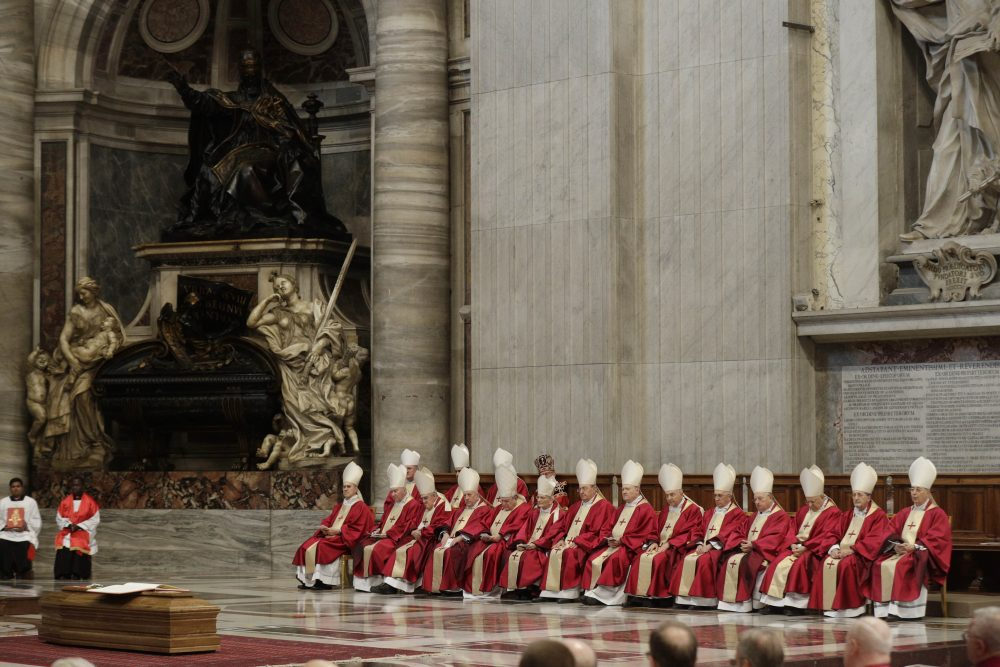 A moment of the funeral service for late Cardinal Bernard Law, at St. Peter's basilica at the Vatican, Thursday, Dec. 21, 2017. Law, who died Wednesday at age 86, resigned in disgrace as archbishop of Boston in 2002 after revelations that he covered up for dozens of priests who raped and sexually molested children, moving them to different parishes without telling parents or police. (Gregorio Borgia/AP)
