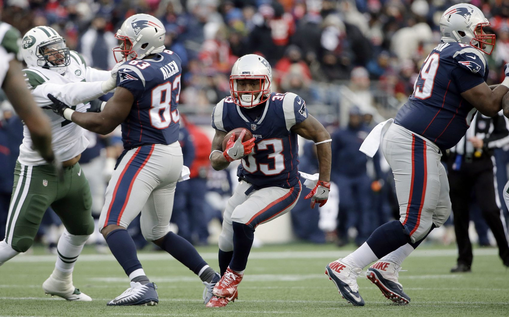 New England Patriots running back Dion Lewis (33) gains yardage against the New York Jets during the second half of an NFL football game, Sunday, Dec. 31, 2017, in Foxborough, Mass. (AP Photo/Steven Senne)