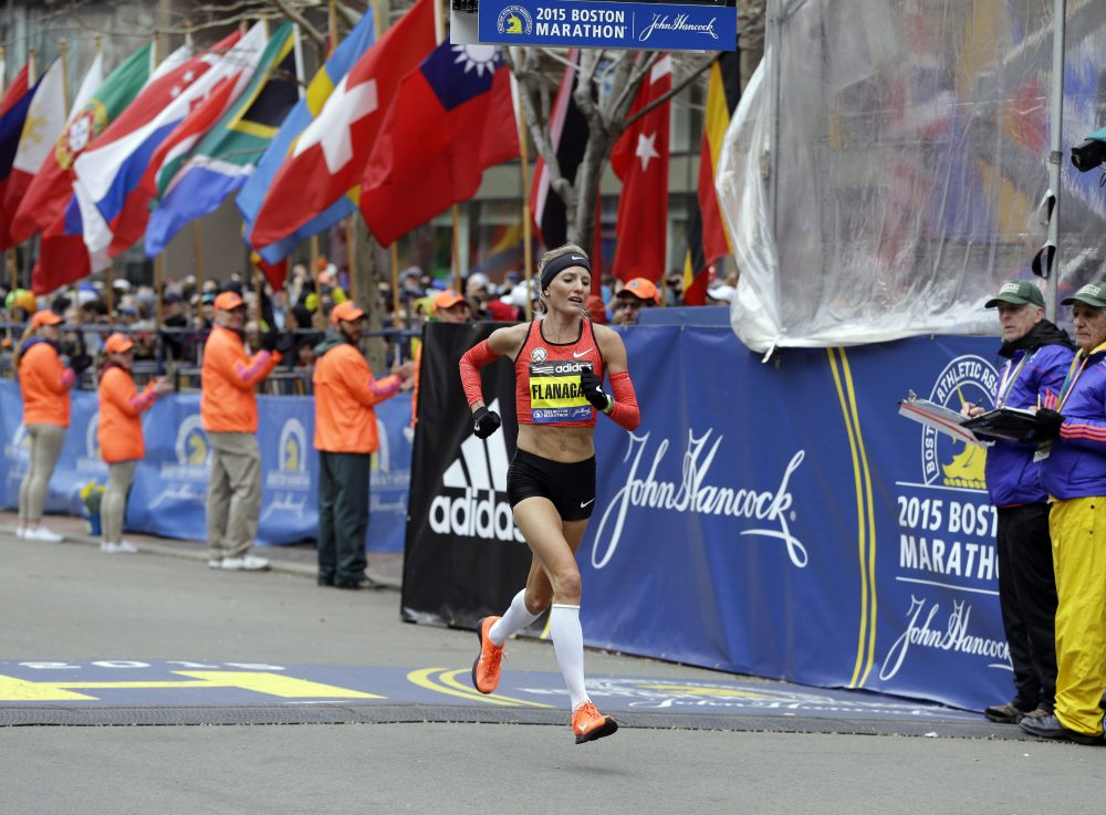 Shalane Flanagan crosses the finish line of the 2015 Boston Marathon. (Elise Amendola/AP)