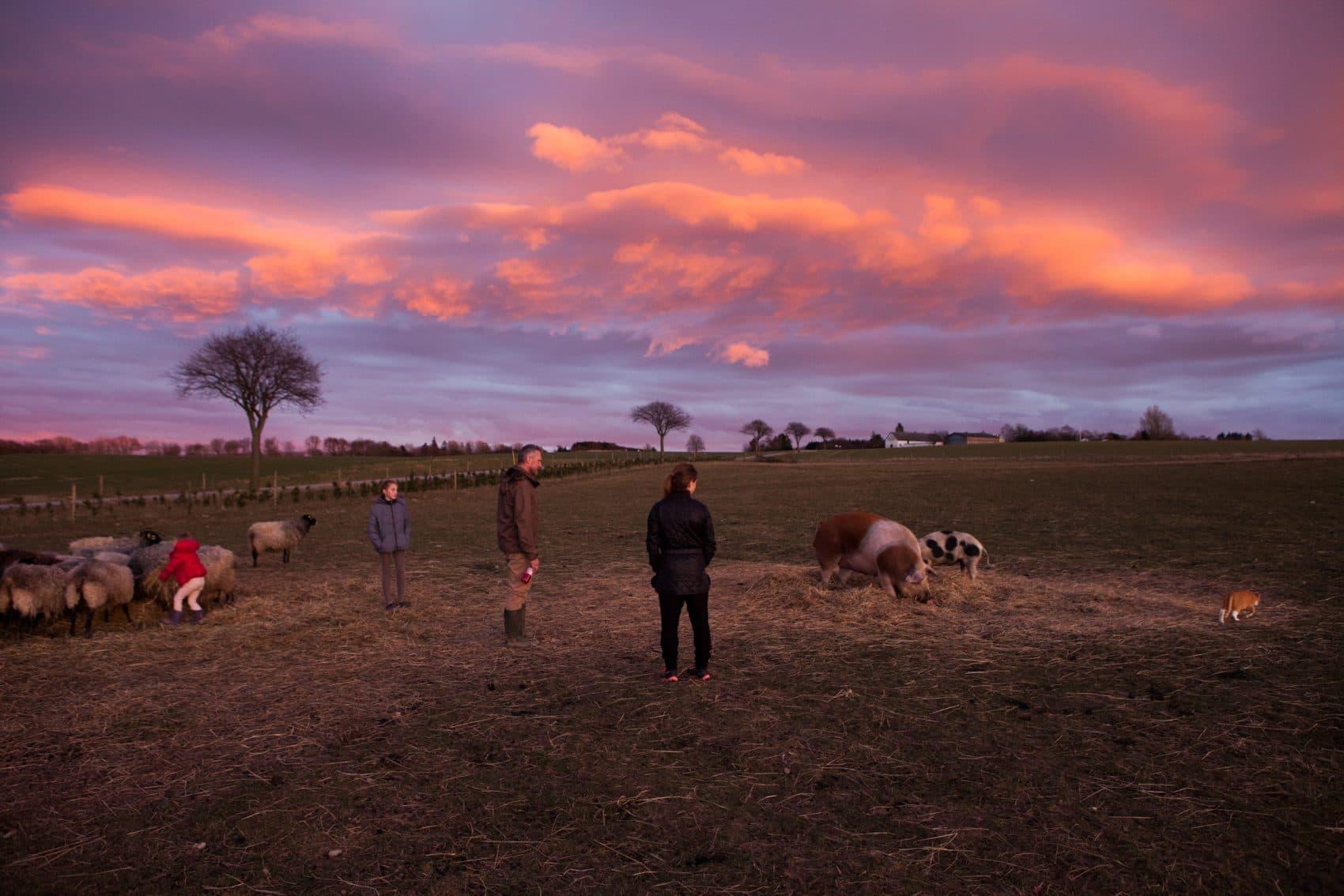 Sine Christiansen, center, with her family on their farm in Denmark (Photo by Rachael Cerrotti)