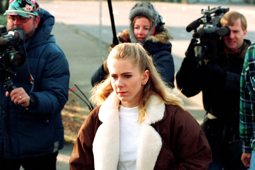 Tonya Harding followed by the media in an AP file photo.