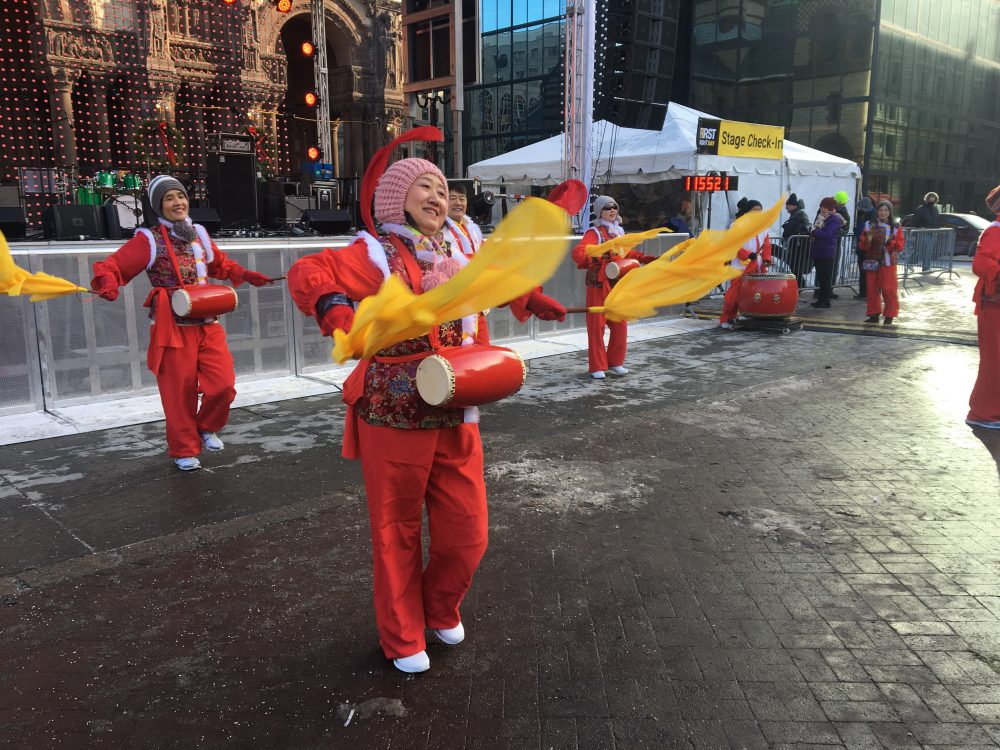 The Boston Chinese Waist Drum Troupe helps kick off First Night festivities in Copley Square. (Simon Rios/WBUR)