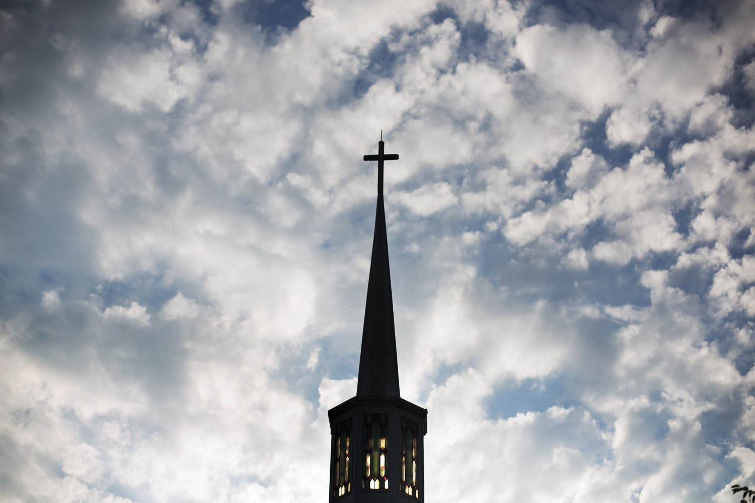 The sun rises behind the steeple of Maranatha Baptist Church Sunday, Aug. 23, 2015, in Plains, Ga. The Baptist church where former President Jimmy Carter teaches Sunday School classes and he and wife Rosalynn are deacons has been at the heart of their life since they returned to Georgia in 1981. On Sunday morning, Carter will teach his first lesson since detailing the intravenous drug doses and radiation treatment planned to treat melanoma found in his brain after surgery to remove a tumor from his liver. (AP Photo/David Goldman)