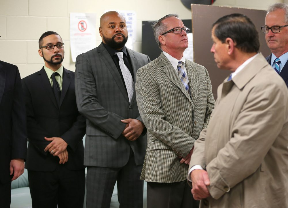 A viewing was held at Bridgewater State Hospital Wednesday in the trial of three former guards accused in the 2009 death of Joshua Messier. From left, the guards on trial are John Raposo, Derek Howard and George Billadeau, while Judge Jeffrey Locke, right, looks back at them. (John Tlumacki/Boston Globe, via Pool)
