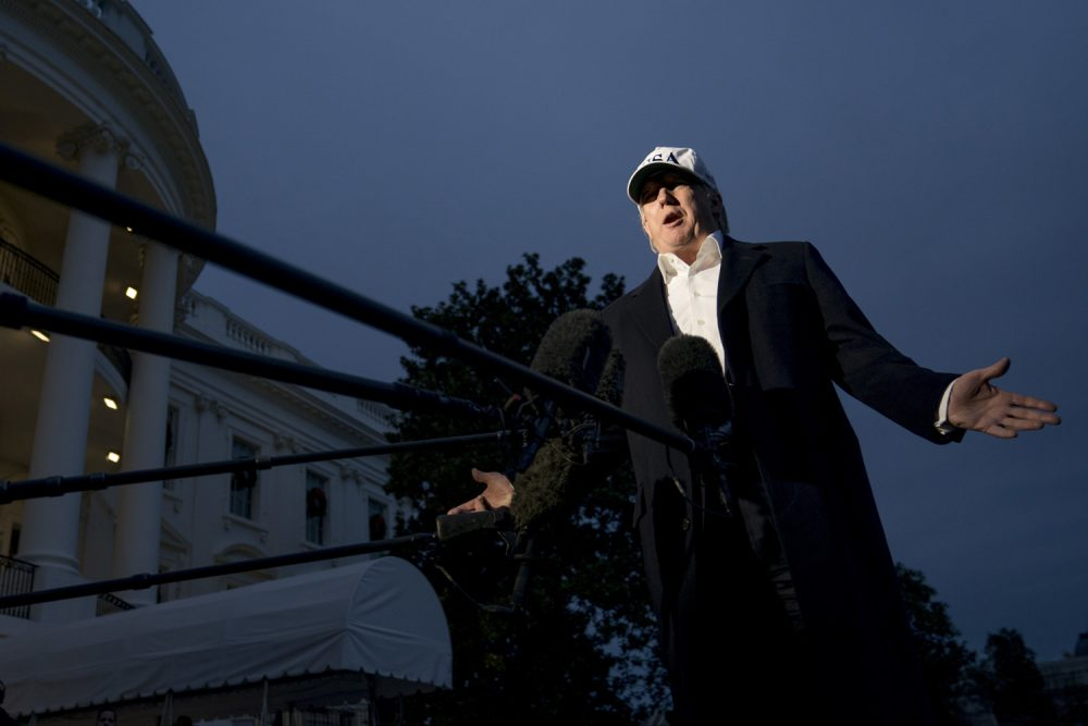 President Donald Trump speaks to members of the media on the South Lawn at the White House in Washington, Sunday, Dec. 17, 2017, as he returns from Camp David in Maryland. Trump says he's not planning to fire special counsel Robert Mueller.. (AP Photo/Andrew Harnik)