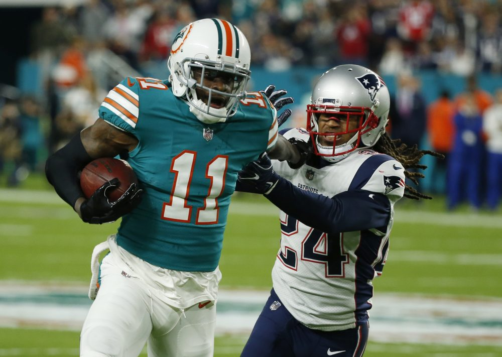 New England Patriots cornerback Stephon Gilmore (24) attempts to tackle Miami Dolphins wide receiver DeVante Parker (11), during the first half of an NFL football game, Monday, Dec. 11, 2017, in Miami Gardens, Fla. (AP Photo/Wilfredo Lee)