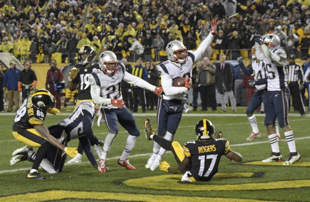 New England Patriots strong safety Duron Harmon, center, celebrates his interception in the end zone of a pass from Pittsburgh Steelers quarterback Ben Roethlisberger (7) during the second half of an NFL football game in Pittsburgh, Sunday, Dec. 17, 2017. The Patriots won 27-24. (AP Photo/Keith Srakocic)