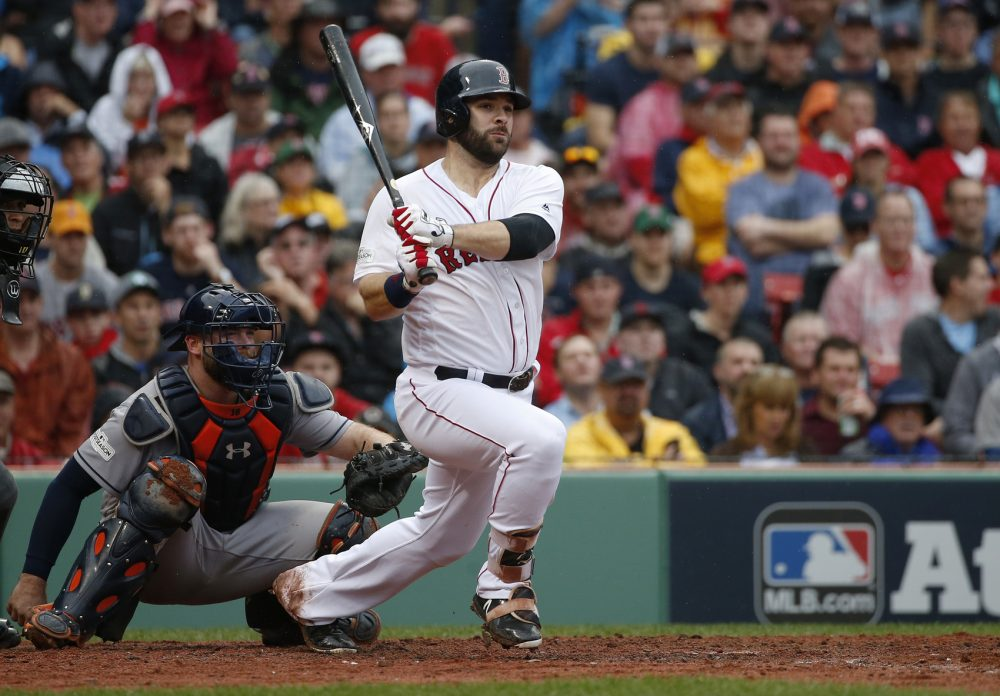 Boston Red Sox's Mitch Moreland hits a double during the third inning in Game 4 of baseball's American League Division Series against the Houston Astros, Monday, Oct. 9, 2017, in Boston. (AP Photo/Michael Dwyer)