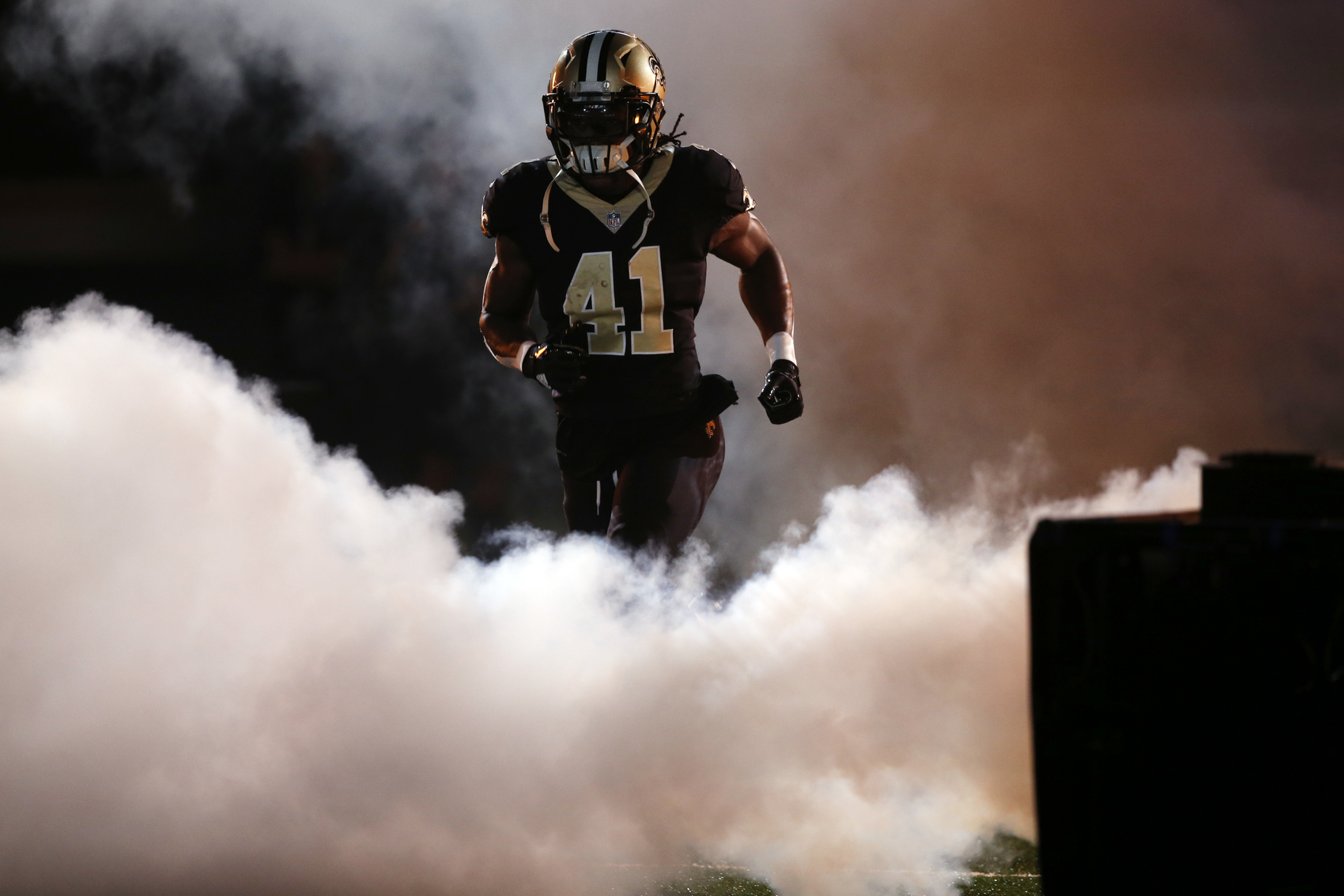 New Orleans Saints running back Alvin Kamara (41) runs on the field for player introductions during pre-game ceremonies before an NFL football game against the Carolina Panthers in New Orleans, Sunday, Dec. 3, 2017. (AP Photo/Gerald Herbert)