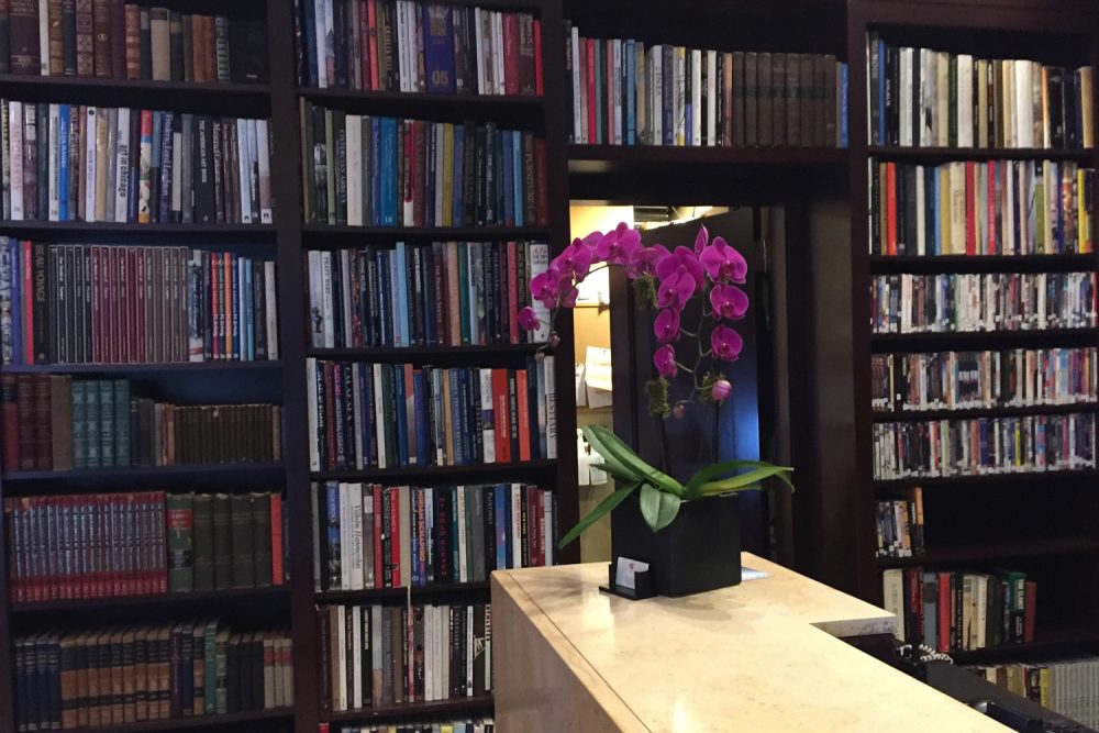 This Nov. 9, 2017 photo shows books on display at the Library Hotel in New York. The hotel has a collection of 6,000 books displayed in the lobby, in guest rooms, in the bar and in a reading room. The floors and rooms are organized using categories from the Dewey Decimal system, like a room themed on love on the philosophy floor. (AP Photo/Beth J. Harpaz)
