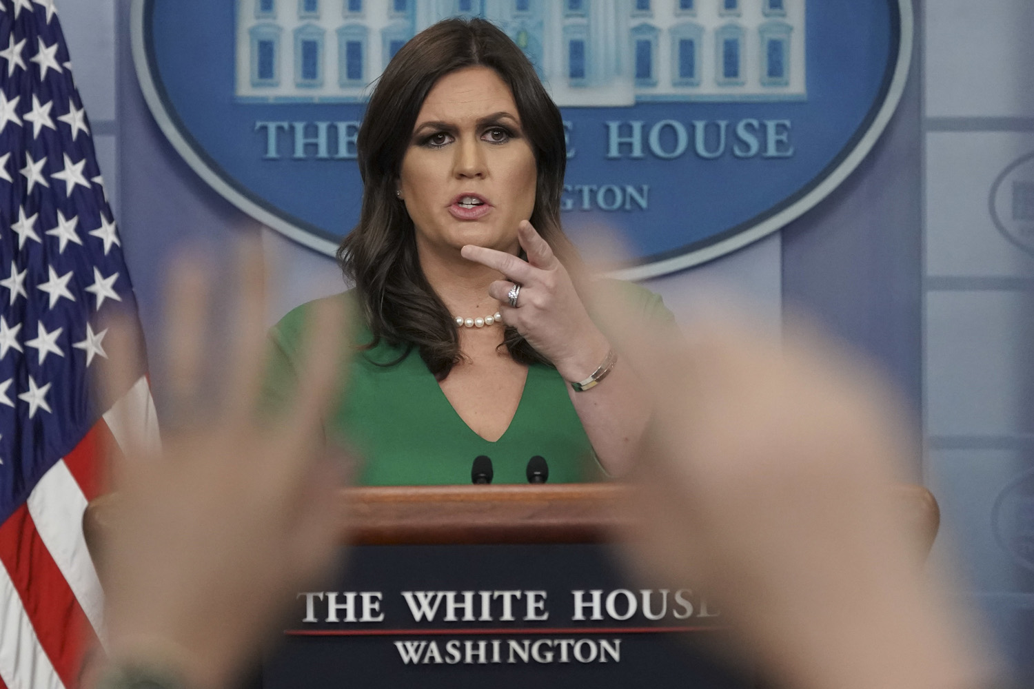 White House press secretary Sarah Huckabee Sanders gestures as she takes questions from the media on Nov. 16, 2017. (Pablo Martinez Monsivais/AP)