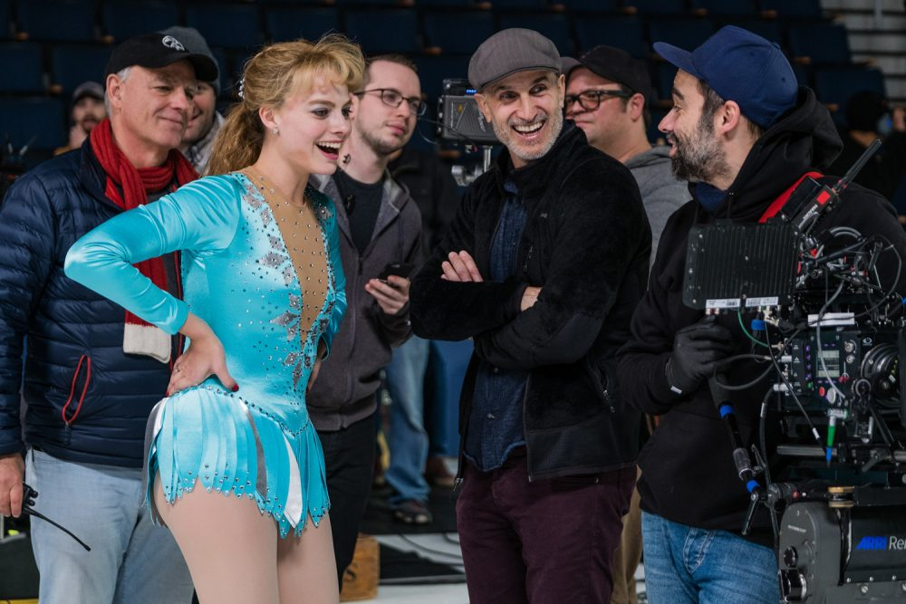 Margot Robbie as Tonya Harding and director Craig Gillespie in a promotional photo.