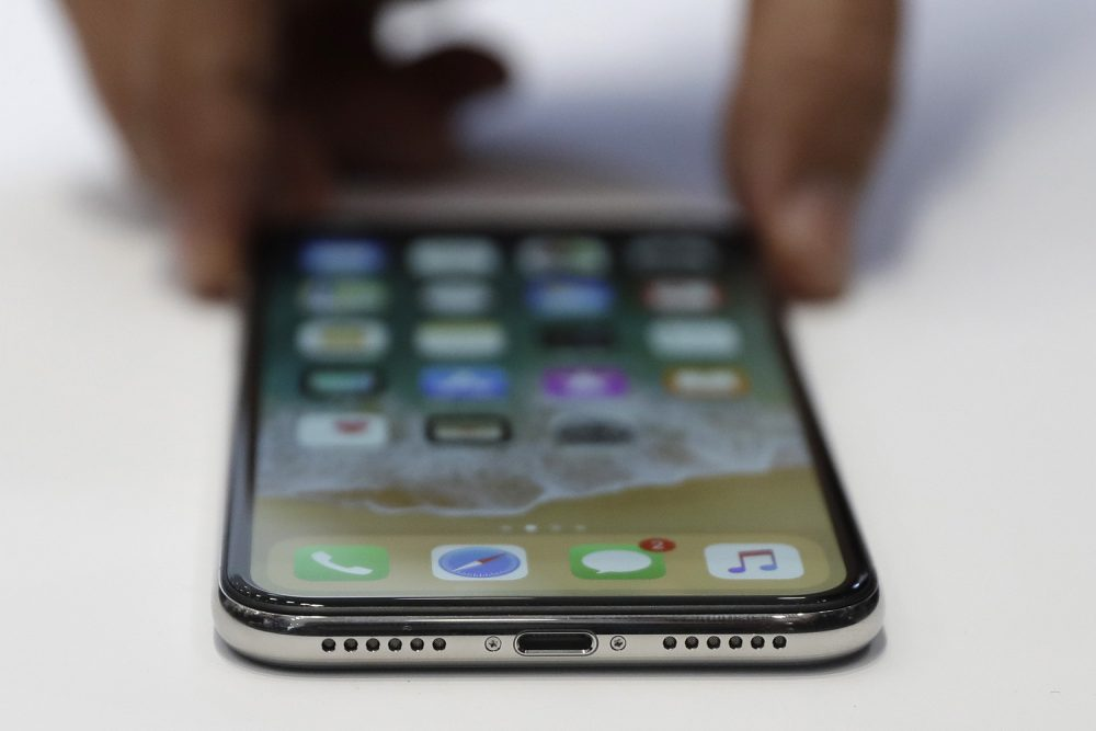 The new iPhone X is displayed on Sept. 12 in Cupertino, Calif. (Marcio Jose Sanchez/AP)