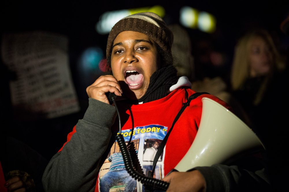 Erica Garner, daughter of Eric Garner, leads a march of people protesting the Staten Island, New York grand jury's decision not to indict a police officer involved in the chokehold death of Eric Garner in July, on Dec. 11, 2014. (Andrew Burton/Getty Images)