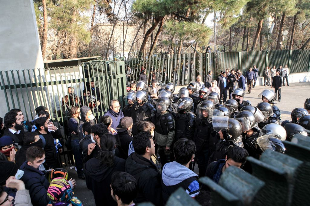 Iranian students scuffle with police at the University of Tehran during a demonstration driven by anger over economic problems, in the capital Tehran on Dec. 30, 2017. (STR/AFP/Getty Images)