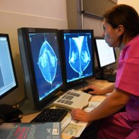 A doctor looks at the results of a breast ultrasound, on Oct. 9, 2017 at the Paoli-Calmette Institute. (Anne-Christine Poujoulat/AFP/Getty Images)
