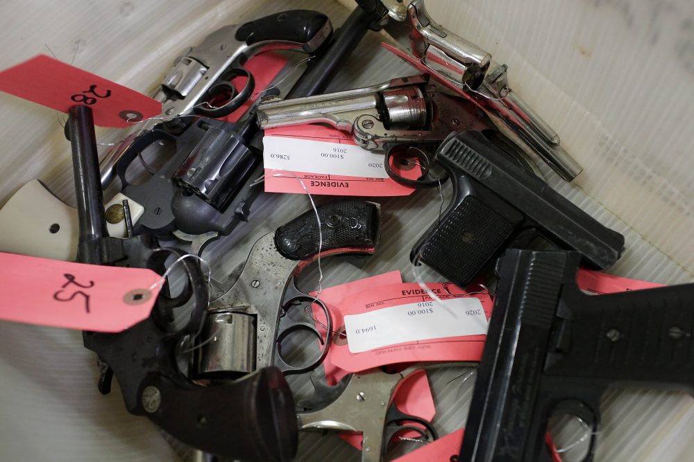 Handguns are seen in a bin during a Chicago Police Department gun turn-in event at Uptown Baptist Church, Nov. 19, 2016, in Chicago. (Joshua Lott/AFP/Getty Images)