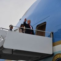 President Trump boards Air Force One in West Palm Beach, Fla., with first lady Melania Trump and son Barron Trump en route to Washington, DC on Jan. 1, 2018. (Nicholas Kamm/AFP/Getty Images)