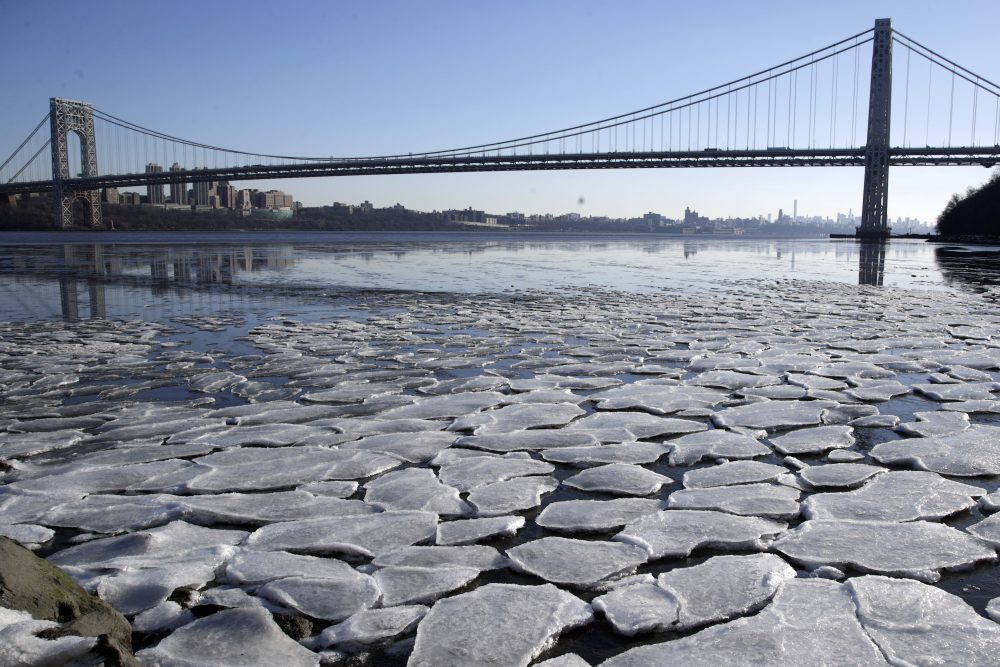 A layer of ice is broken into pieces floating along the banks of the Hudson River at the Palisades Interstate Park with the George Washington Bridge in the background, Tuesday, Jan. 2, 2018, in Fort Lee, N.J. (Julio Cortez/AP)