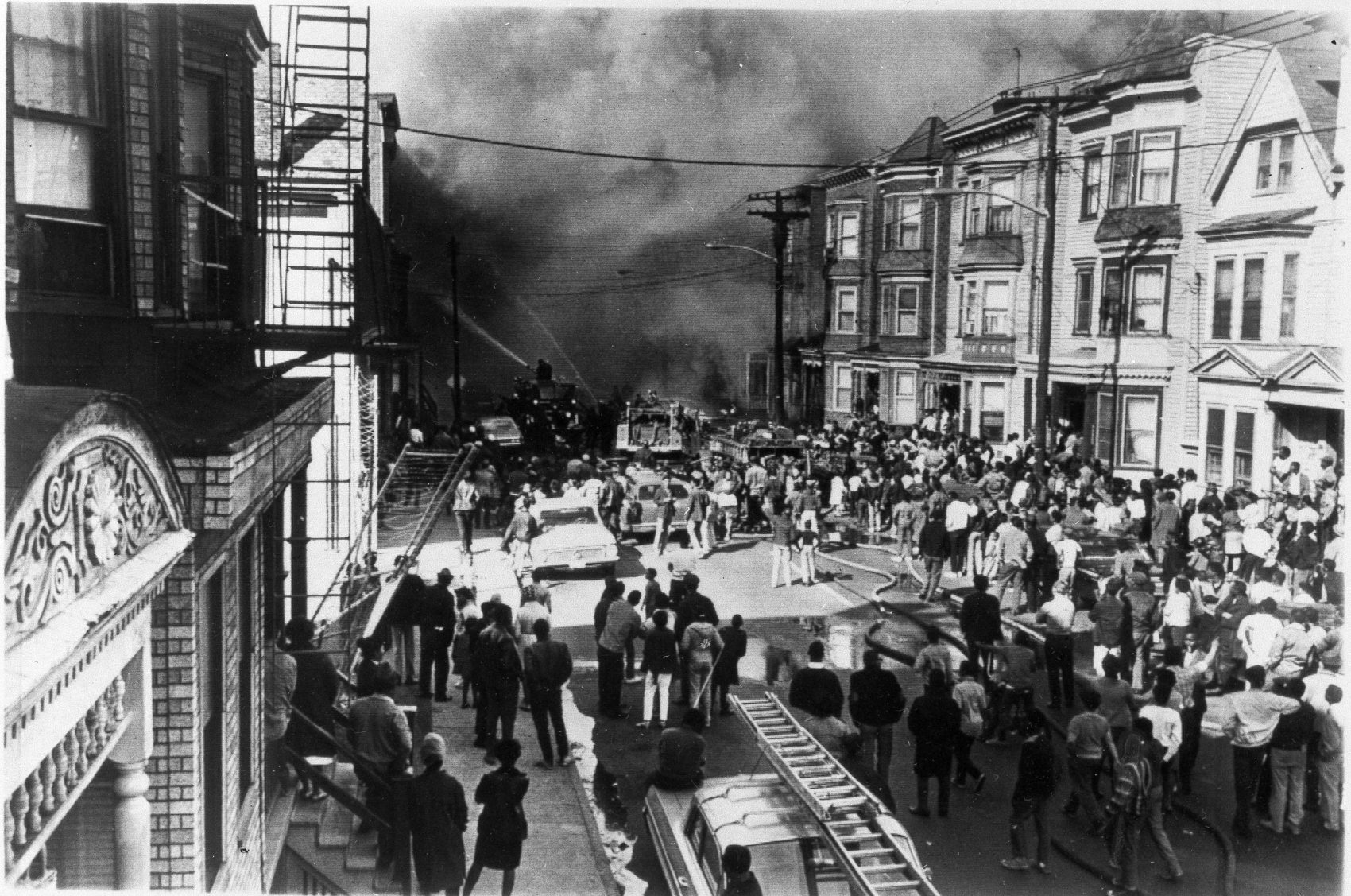 A Major fire in Newark, N.J., drew a large crowd of onlookers watching firemen pour water onto the burning building, April 6, 1968. City officials reported some firebomb incidents in response to the assassination of Martin Luther King Jr. in Memphis, Tenn. (AP Photo)