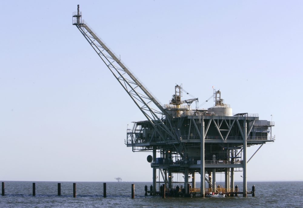 A natural gas platform is shown off the coast of Fort  Morgan, Ala., in 2007. (Rob Carr/AP)