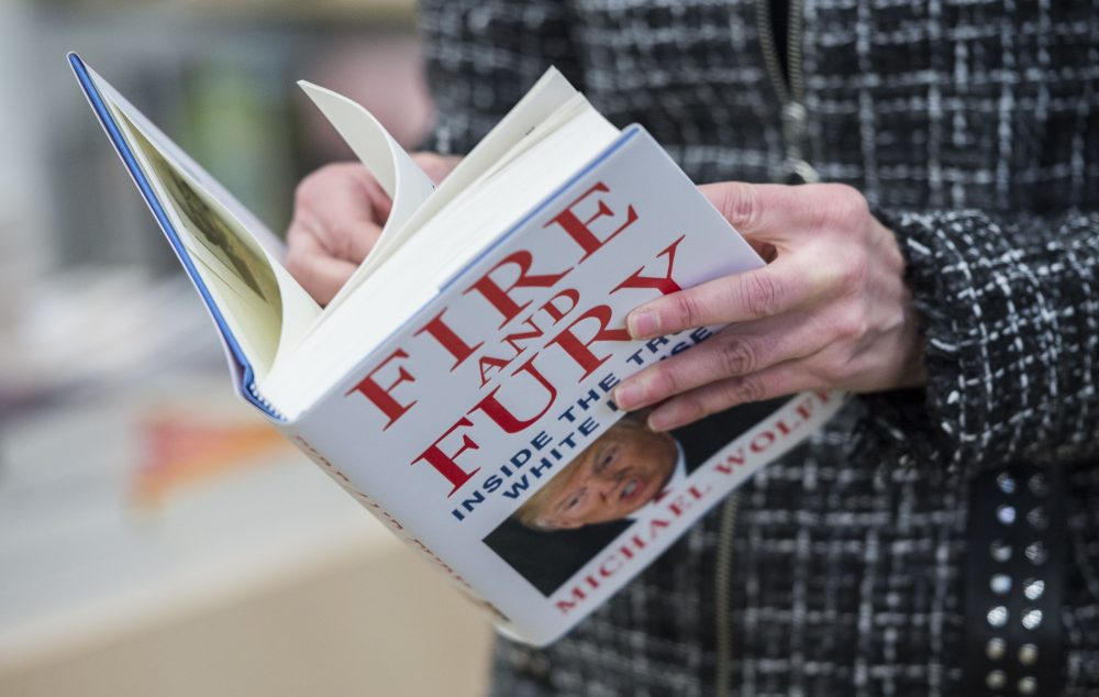 "A man holds a copy of the book ""Fire and Fury: Inside the Trump White House"" by Michael Wolff, after buying it at a bookstore in Washington, D.C. on Jan. 5, 2018. The book was rushed into bookstores and onto e-book platforms four days ahead of schedule due to what its publisher called ""unprecedented demand"" — and after Trump's bid to block it failed. (Andrew Caballero-Reynolds/AFP/Getty Images)"