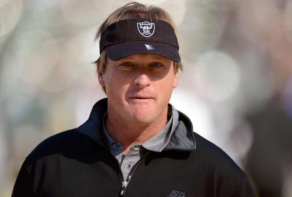 Monday Night Football analyst Jon Gruden, pictured here in 2002, will return to coach the Oakland Raiders. (Thearon W. Henderson/Getty Images)