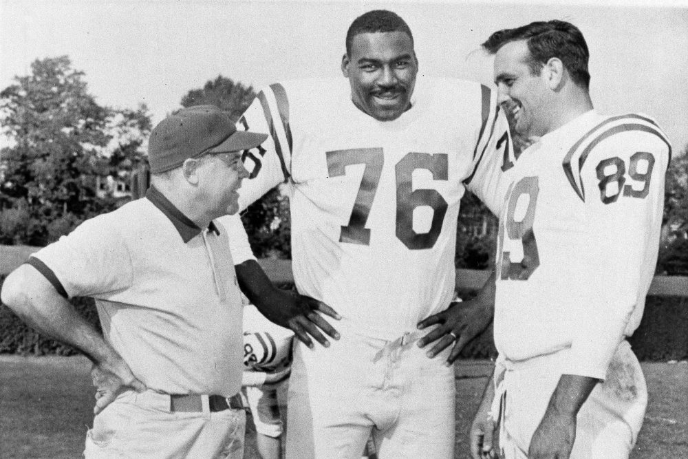 Baltimore Colts coach Weeb Ewbank (left) with players Gene Lipscomb (center) and Gino Marchetti in 1958. The Colts left Baltimore after the 1983 season. (William A. Smith/AP)