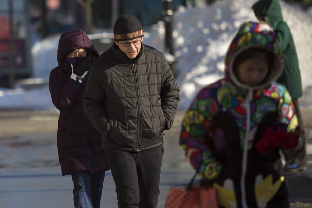 Pedestrians walk in the frigid air in Kendall Square. (Jesse Costa/WBUR)