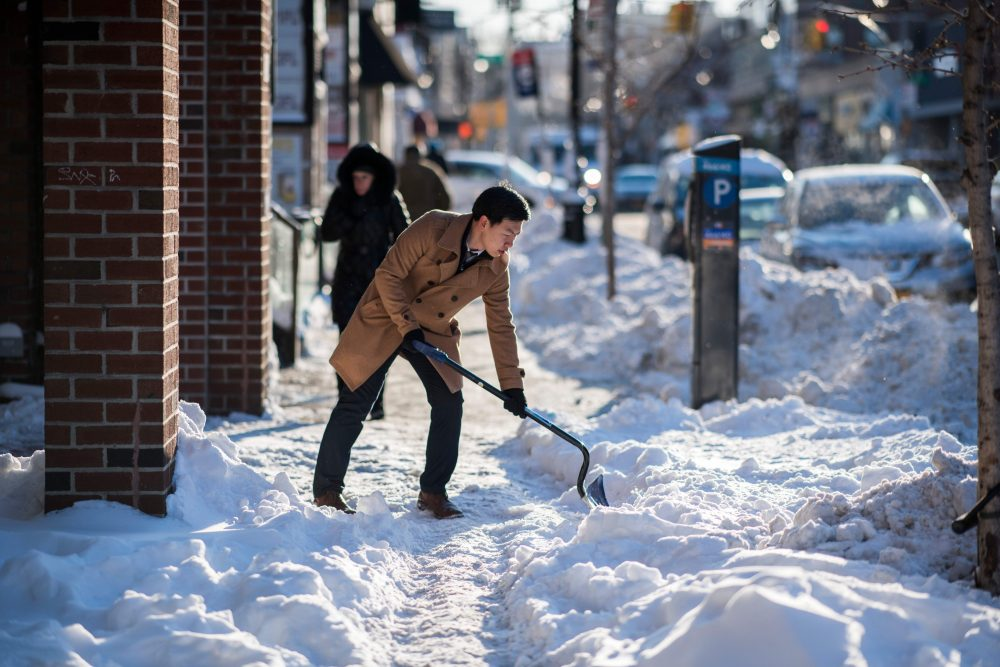 A man shovels snow from a footpath during a cold morning in New York on Jan. 5, 2018. (Jewel Samad/AFP/Getty Images)