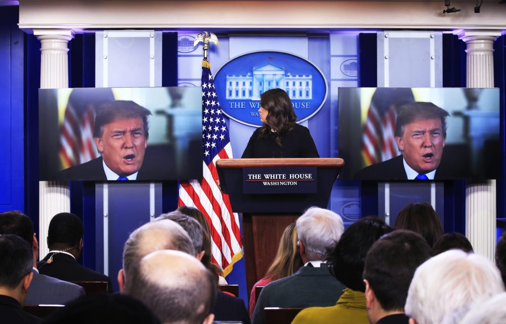 President Trump speaks via a video monitor to journalists at the White House in Washington during the daily press briefing with press secretary Sarah Huckabee Sanders, Thursday, Jan. 4, 2018. (Manuel Balce Ceneta/AP)