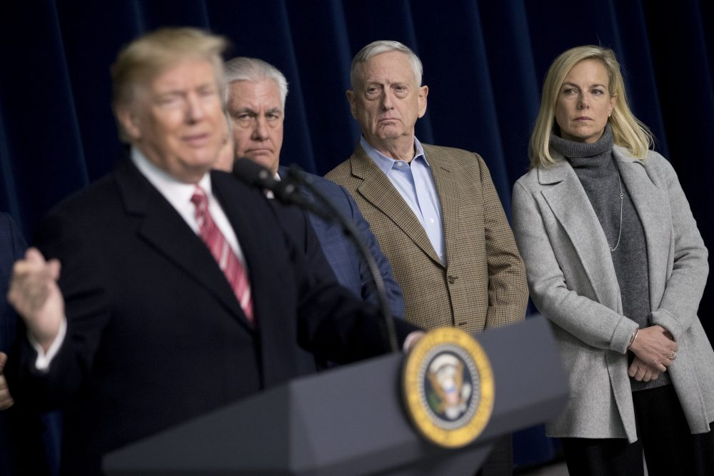 From left, President Trump, accompanied by Secretary of State Rex Tillerson, Defense Secretary Jim Mattis and Secretary of Homeland Security Kirstjen Nielsen, speaks to members of the media after participating in a Congressional Republican Leadership Retreat at Camp David, Md., Saturday, Jan. 6, 2018. (Andrew Harnik/AP)
