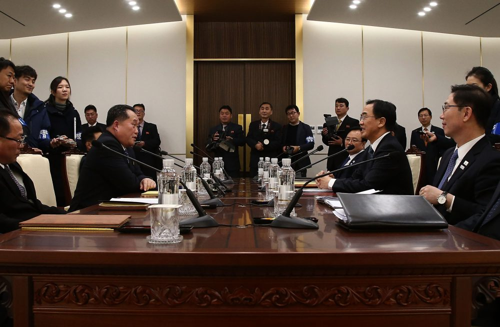 South Korean unification Minister Cho Myoung-Gyon (right) talks with the head of the North Korean delegation Ri Son-Gwon during their meeting at Panmunjom in the Demilitarized Zone on Jan. 9, 2018 in Panmunjom, South Korea. South and North Korea are scheduled to begin their first official face-to-face talks in two years on Tuesday, Jan. 9, 2017. (Korea Pool/Getty Images)