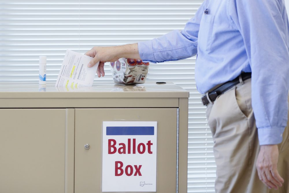 A voter casts a ballot on the first day of early voting at the Hamilton County Board of Elections, Wednesday, Oct. 11, 2017, in Cincinnati. (John Minchillo/AP)