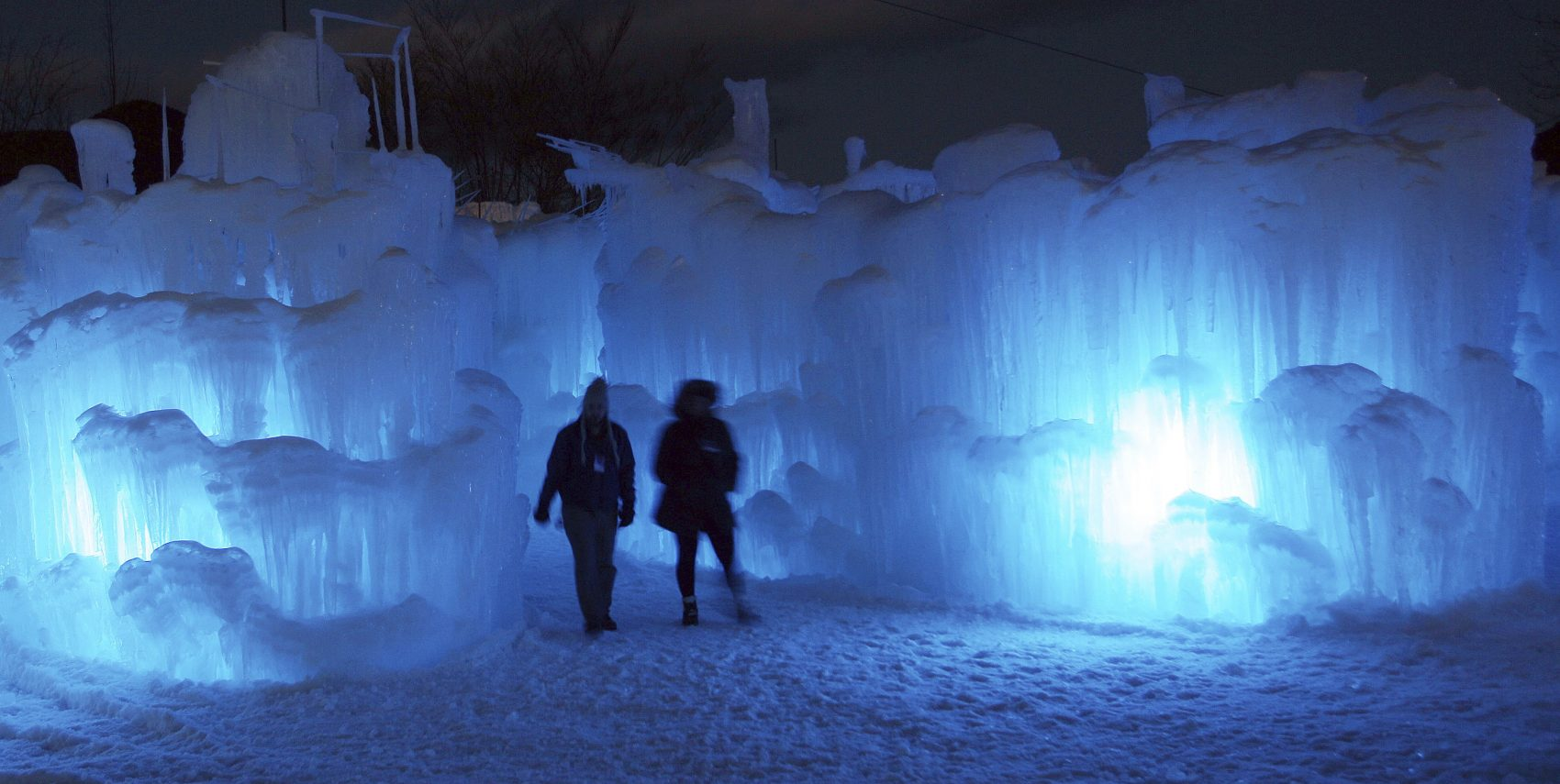 People tour an ice castle in Lincoln, New Hampshire in 2014. (Jim Cole/AP)